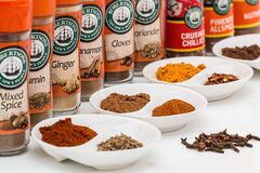 Spice jars and spices Stock Image