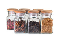 Spice jars with spices on white background. Set spice jars on white background - grain mustard, cloves, star anise, paprika Stock Photo