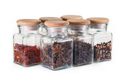 Spice jars with spices on white background. Set spice jars on white background - pepper, cloves, star anise, paprika Royalty Free Stock Photography