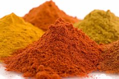 Spice Mix. Collection of different hot and exotically spices as closeup on white background Stock Images