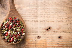 Spice. Spice mix a wooden spoon on a wooden background Royalty Free Stock Image
