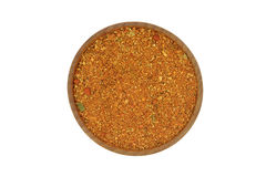 Spice mixes for meat in a wooden bowl. On a white background Stock Image