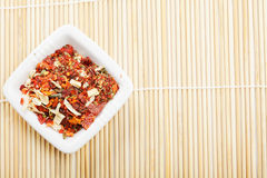 Spice mixture for soup in dish on mat Stock Images