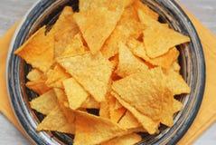 Spice Nachos Chips Close Up. Blue Dark Rustic Plate. Orange Napkin. Snack chips. stock photos