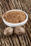 Spice nutmeg in whole and ground Stock Photos
