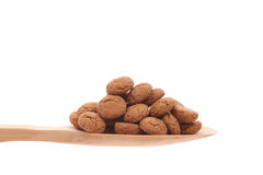 Spice-nuts on a wooden spoon Royalty Free Stock Photo
