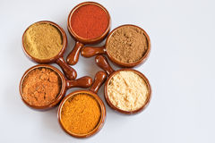 Spice Pots. Six pots of spices against a white background Stock Photo