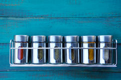 Spice rack on a wooden wall Royalty Free Stock Image