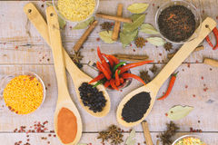 Spice with red pepper on a wooden background with different grits Stock Photo