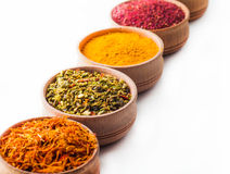 Spice saffron,paprika,sumac,turmeric,green pepper in a wooden bowl Royalty Free Stock Photo