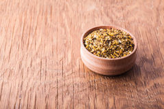 Spice salt in a wooden bowl Stock Photos