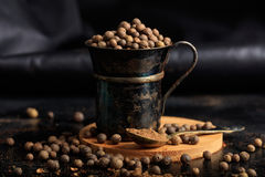 Spice seeds and powder. On a black background Stock Images