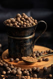 Spice seeds and powder. On a black background Royalty Free Stock Photo