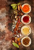 Spice Selection, flat lay. Spice Selection on brown Concrete Texture stock photos