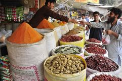 Spice seller at the market. Selling food ingredients Royalty Free Stock Image