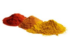 Spice set. An assortment of red, orange and yellow spices Stock Images