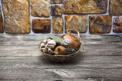 Spice set in wicker basket onion, Provence herbs, garlic at the table in the kitchen Royalty Free Stock Image