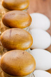 Spice sets with wooden lid arranged in a row with white eggs Stock Photo