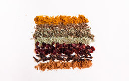 Spice. Seven spice on the white table royalty free stock photo