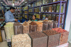 Spice shop. Kochi, India - December 11, 2016 - Clients bargaining and buying fresh spices in indian shop Royalty Free Stock Photos