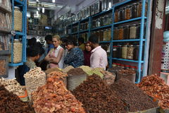 Spice shop. Kochi, India - November 6, 2015 - Clients bargaining and buying fresh spices in indian shop Stock Photos