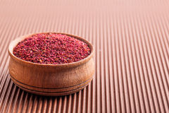 Spice sumac in a wooden bowl Stock Photos