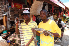 Spice Vendors Displaying Goods in Africa. KAMPALA, UGANDA - SEPTEMBER 29 2012. Two young male spice vendors display the goods they have for sale in the food Royalty Free Stock Photo