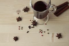 Spice and wine on wooden table. Spice and red wine in the glass on wooden table Royalty Free Stock Image
