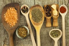 Spice in Wooden spoon. Herbs. Cinnamon and other on a wooden rustic background. Pepper. Large collection of different spices and. Herbs. Salt, paprika. Sale of stock photos