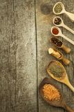 Spice in Wooden spoon. Herbs. Cinnamon and other on a wooden rustic background. Pepper. Large collection of different spices and. Herbs. Salt, paprika. Sale of royalty free stock photo