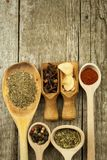 Spice in Wooden spoon. Herbs. Cinnamon and other on a wooden rustic background. Pepper. Large collection of different spices and. Herbs. Salt, paprika. Sale of royalty free stock photos
