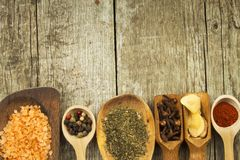 Spice in Wooden spoon. Herbs. Cinnamon and other on a wooden rustic background. Pepper. Large collection of different spices and. Herbs. Salt, paprika. Sale of stock photography