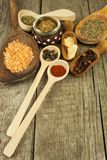 Spice in Wooden spoon. Herbs. Cinnamon and other on a wooden rustic background. Pepper. Large collection of different spices and. Herbs. Salt, paprika. Sale of royalty free stock images