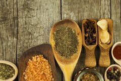 Spice in Wooden spoon. Herbs. Cinnamon and other on a wooden rustic background. Pepper. Large collection of different spices and. Herbs. Salt, paprika. Sale of stock photo