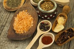 Spice in Wooden spoon. Herbs. Cinnamon and other on a wooden rustic background. Pepper. Large collection of different spices and. Herbs. Salt, paprika. Sale of royalty free stock image