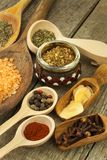 Spice in Wooden spoon. Herbs. Cinnamon and other on a wooden rustic background. Pepper. Large collection of different spices and. Herbs. Salt, paprika. Sale of stock images