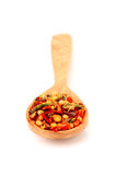 Spice in wooden spoon isolated. Stock Photo