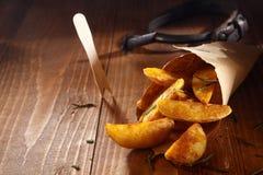 Spiced золотистые клин картошки Стоковая Фотография