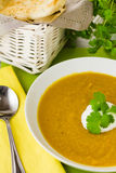 Spiced Carrot and Lentil soup with spoon Royalty Free Stock Photography