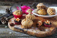 Spiced Carrot muffins and burning candles Stock Photos