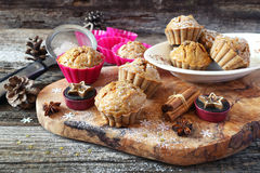 Spiced Carrot muffins, candles and pine cones Stock Photo