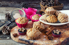 Spiced Carrot muffins and pine cones. New Year mood: spiced Carrot muffins and pine cones Royalty Free Stock Photos