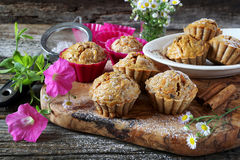 Spiced carrot muffins and summer flowers Royalty Free Stock Photos