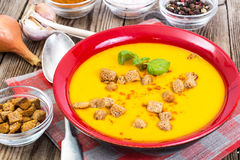 Spiced carrot puree with croutons Royalty Free Stock Photo