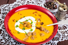 Spiced carrot puree with croutons Stock Images