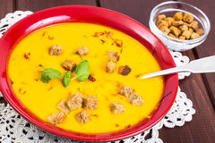 Spiced carrot puree with croutons Stock Photo