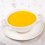 Spiced carrot soup in a bowl, on the white table Stock Photography