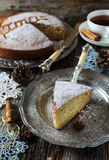 Spiced Christmas cake and crocheted snowflakes Stock Photography