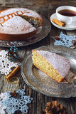 Spiced Christmas cake and crocheted snowflakes Stock Images