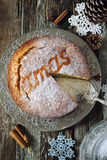 Spiced Christmas cake and crocheted snowflakes Royalty Free Stock Image